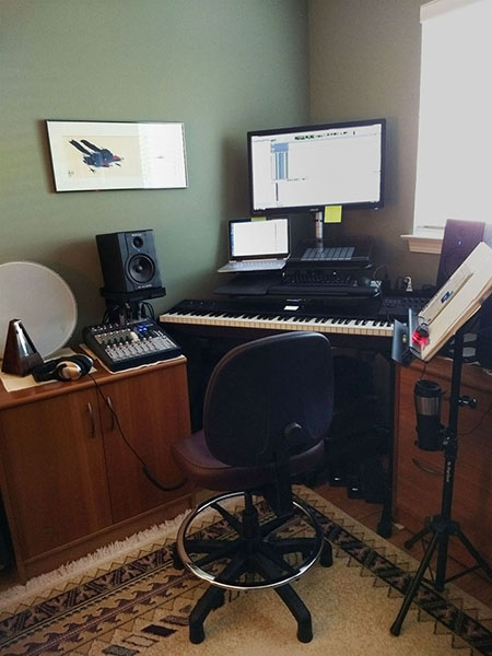 Photo: my main workspace (piano keyboard, computer, speakers, mixing board...)